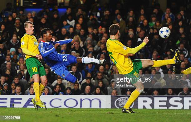 Daniel Sturridge of Chelsea shoots at goal under a challenge from Tomas Majtan of MSK Zilina during the UEFA Champions League Group F match between...