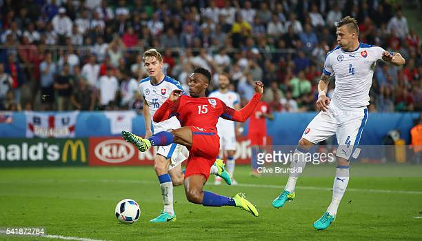 Daniel Sturridge of England attempts a shot at goal during the UEFA EURO 2016 Group B match between Slovakia and England at Stade GeoffroyGuichard on...