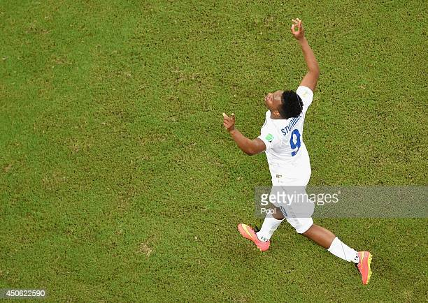 Daniel Sturridge of England celebrates after scoring his team's first goal during the 2014 FIFA World Cup Brazil Group D match between England and...