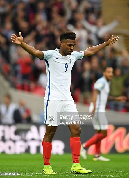 Daniel Sturridge of England celebrates after scoring the opening goal of the game during the FIFA 2018 World Cup Qualifier Group F match between...