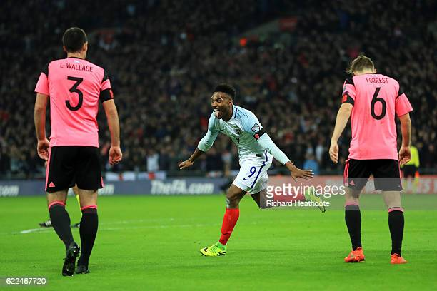 Daniel Sturridge of England celebrates as he scores their first goal during the FIFA 2018 World Cup qualifying match between England and Scotland at...