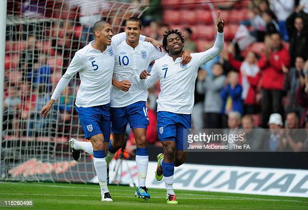 Daniel Sturridge of England celebrates his goal with Jack Rodwell and Chris Smalling during the Under-21 International Friendly match between England...