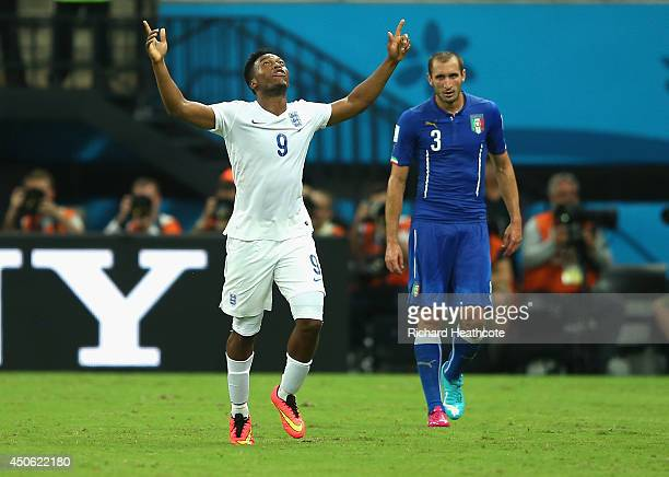 Daniel Sturridge of England celebrates scoring his team's first goal as Giorgio Chiellini of Italy looks on during the 2014 FIFA World Cup Brazil...