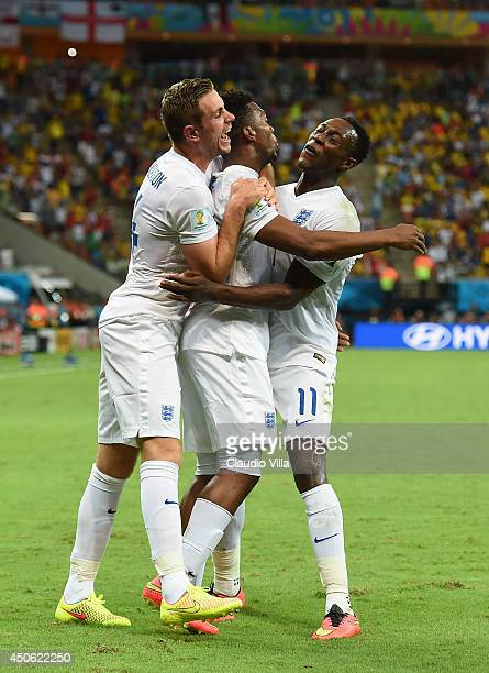 Daniel Sturridge of England celebrates scoring his team's first goal with Jordan Henderson and Danny Welbeck during the 2014 FIFA World Cup Brazil...