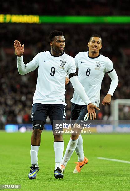 Daniel Sturridge of England celebrates scoring the first goal with Chris Smalling of England during the International Friendly match between England...