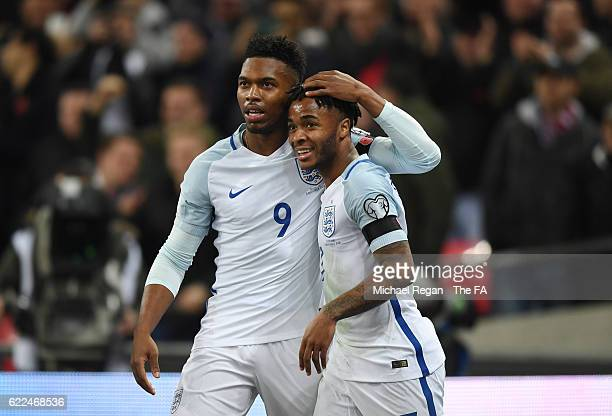Daniel Sturridge of England celebrates scoring the opening goal with his team mate Raheem Sterling during the FIFA 2018 World Cup Qualifier between...