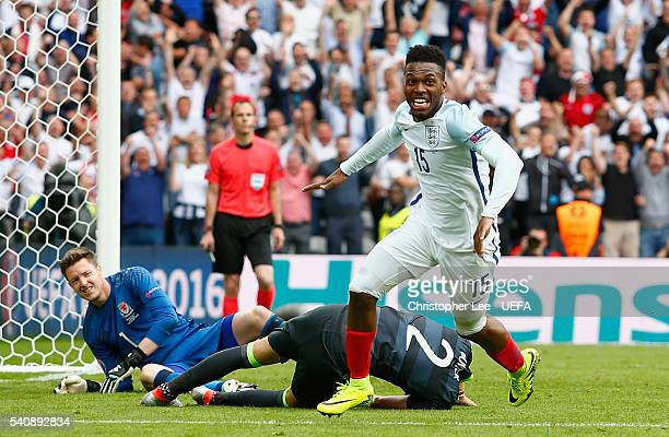 Daniel Sturridge of England celebrates scoring the winning goal as Wayne Hennessey and Chris Gunter of Wales look dejected during the UEFA EURO 2016...
