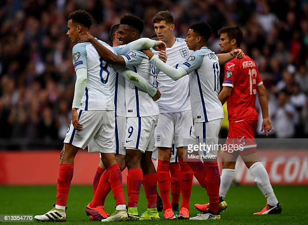 Daniel Sturridge of England celebrates with team mates after scoring the opening goal of the game during the FIFA 2018 World Cup Qualifier Group F...