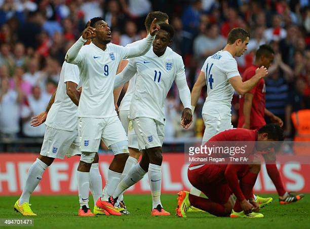 Daniel Sturridge of England celebrates with team mates as he scores their first goal during the International Friendly match between England and Peru...