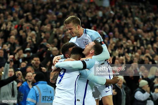 Daniel Sturridge of England celebrates with team mates as he scores their first goal during the FIFA 2018 World Cup qualifying match between England...