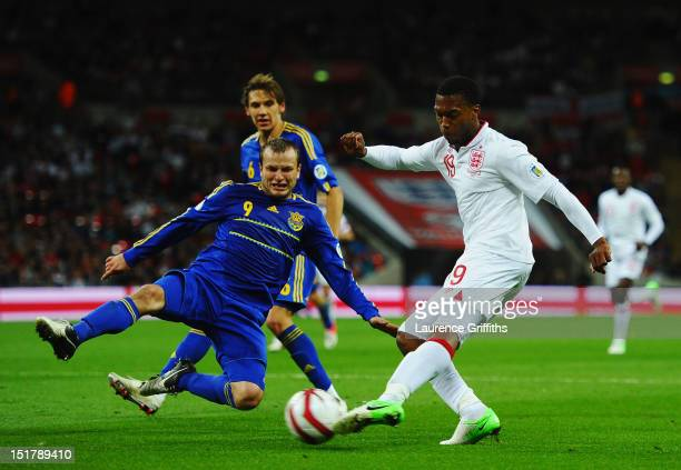 Daniel Sturridge of England crosses the ball ahead Oleg Gusev of Ukraine during the FIFA 2014 World Cup Group H qualifying match between England and...