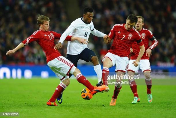 Daniel Sturridge of England is tackled by Jesper Juelsgard and William Kvist of Denmark during the International Friendly match between England and...
