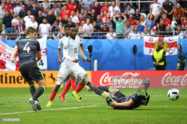 Daniel Sturridge of England scores England's second goal during the UEFA EURO 2016 Group B match between England and Wales at Stade BollaertDelelis...