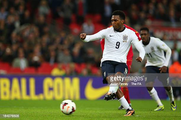 Daniel Sturridge of England scores his team's fourth goal from the penalty spot during the FIFA 2014 World Cup Qualifying Group H match between...