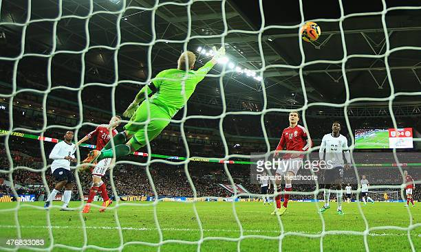 Daniel Sturridge of England scores the opening goal past Kasper Schmeichel of Denmark during the International Friendly match between England and...