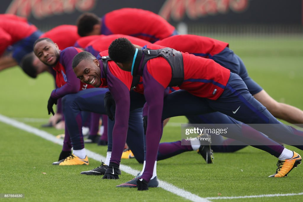 Daniel Sturridge of England smiles in a warm up during an England training session at Hotspur Way on October 4, 2017 in Enfield, England.