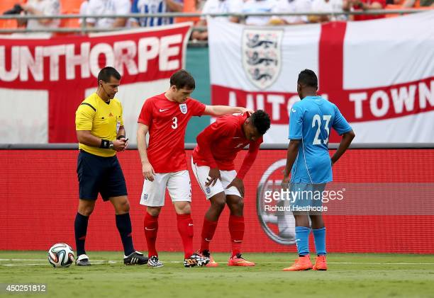 Daniel Sturridge of England sustains a heavy tackle during the International Friendly match between England and Honduras at the Sun Life Stadium on...