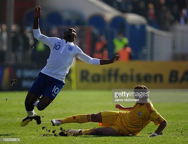 Daniel Sturridge of England U21 battles with Cornel Rapa of Romania U21 during the UEFA Euro 2011 U21 Championship play-off, second leg match between...