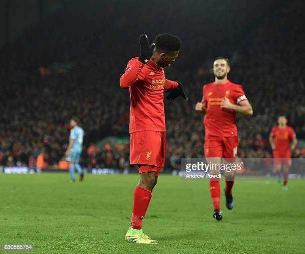 Daniel Sturridge of Liveprool celebrates scoring his team's fourth goal during the Premier League match between Liverpool and Stoke City at Anfield...