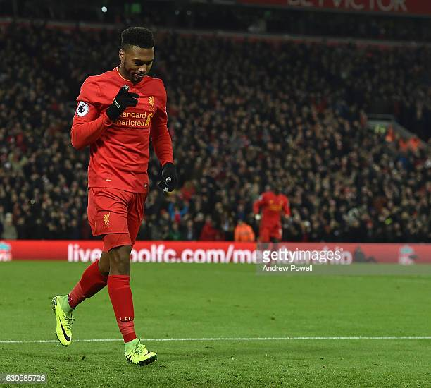 Daniel Sturridge of Liveproolcelebrates scoring his team's fourth goal during the Premier League match between Liverpool and Stoke City at Anfield on...