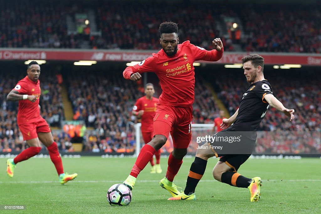 Daniel Sturridge of Liverpoo (L)l is fouled by Andrew Robertson of Hull City (R) for a penalty during the Premier League match between Liverpool and Hull City at Anfield on September 24, 2016 in Liverpool, England.