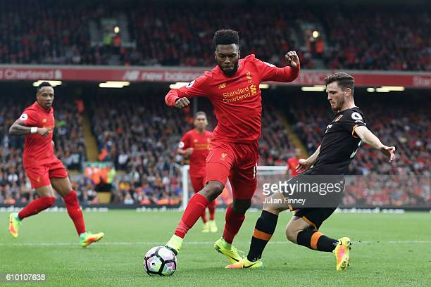 Daniel Sturridge of Liverpoo l is fouled by Andrew Robertson of Hull City for a penalty during the Premier League match between Liverpool and Hull...
