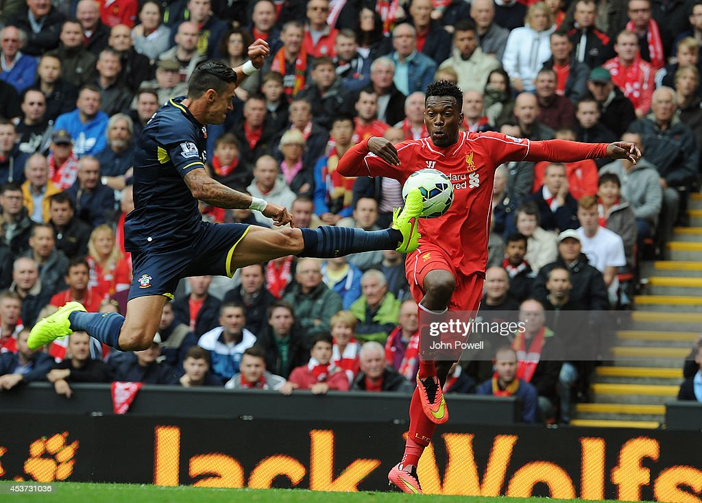 Daniel Sturridge of Liverpool and Graziano Pelle of Southampton compete during the Premier League match between Liverpool and Southampton at Anfield on August 17, 2014 in Liverpool, England.