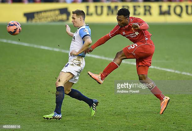 Daniel Sturridge of Liverpool and Matthew Kilgallon of Blackburn Rovers compete during the FA Cup Quarter Final match between Liverpool and Blackburn...