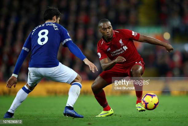 Daniel Sturridge of Liverpool attempts to move past Andre Gomes of Everton during the Premier League match between Liverpool FC and Everton FC at...