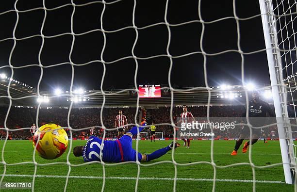 Daniel Sturridge of Liverpool beats goalkeeper Maarten Stekelenburg of Southampton to score their second goal during the Capital One Cup quarter...