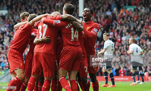 Daniel Sturridge of Liverpool celebrate thew first goal with the team during the Barclays Premier League match between Liverpool and Tottenham...