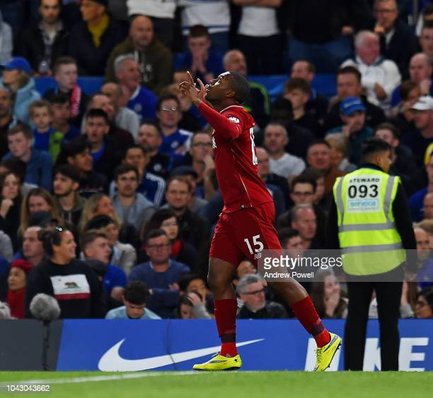 Daniel Sturridge of Liverpool celebrates after scoring the equalising goal during the Premier League match between Chelsea FC and Liverpool FC at...