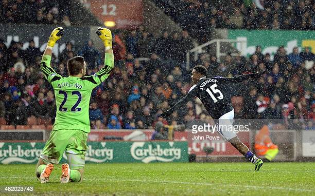 Daniel Sturridge of Liverpool celebrates after scoring the fifth goal during the Barclays Premier Leauge match between Stoke City and Liverpool at...