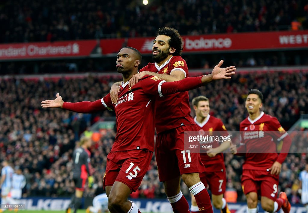 Daniel Sturridge of Liverpool celebrates after scoring the opener during the Premier League match between Liverpool and Huddersfield Town at Anfield on October 28, 2017 in Liverpool, England.