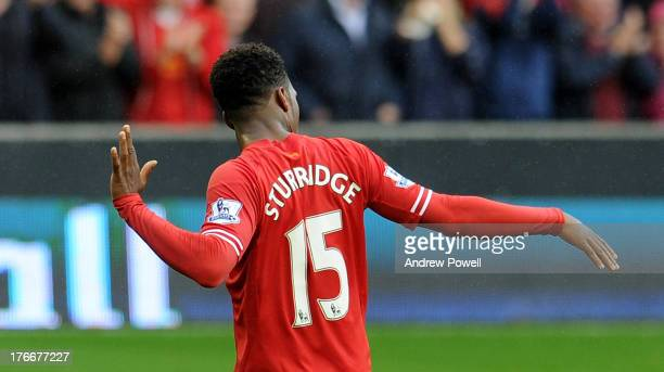 Daniel Sturridge of Liverpool celebrates after scoring the opening goal during the Barclays Premier League match between Liverpool and Stoke City at...
