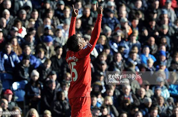 Daniel Sturridge of Liverpool celebrates after scoring the opening goal during the Barclays Premier Leauge match between West Bromwich Albion and...