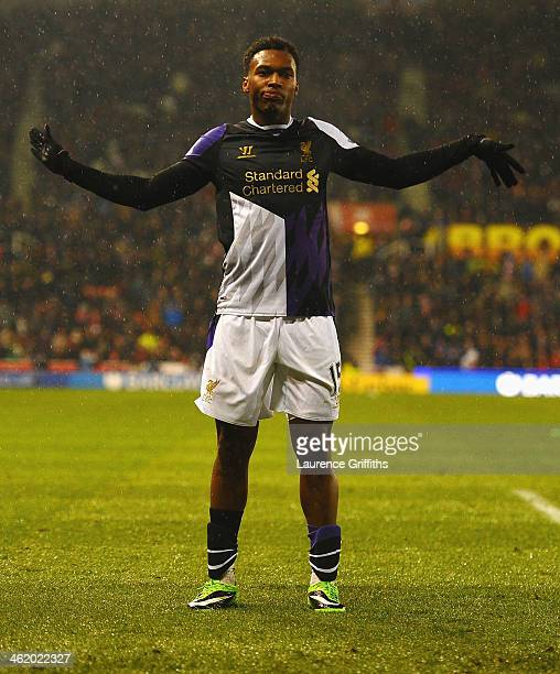Daniel Sturridge of Liverpool celebrates as he scores their fifth goal during the Barclays Premier League match between Stoke City and Liverpool at...