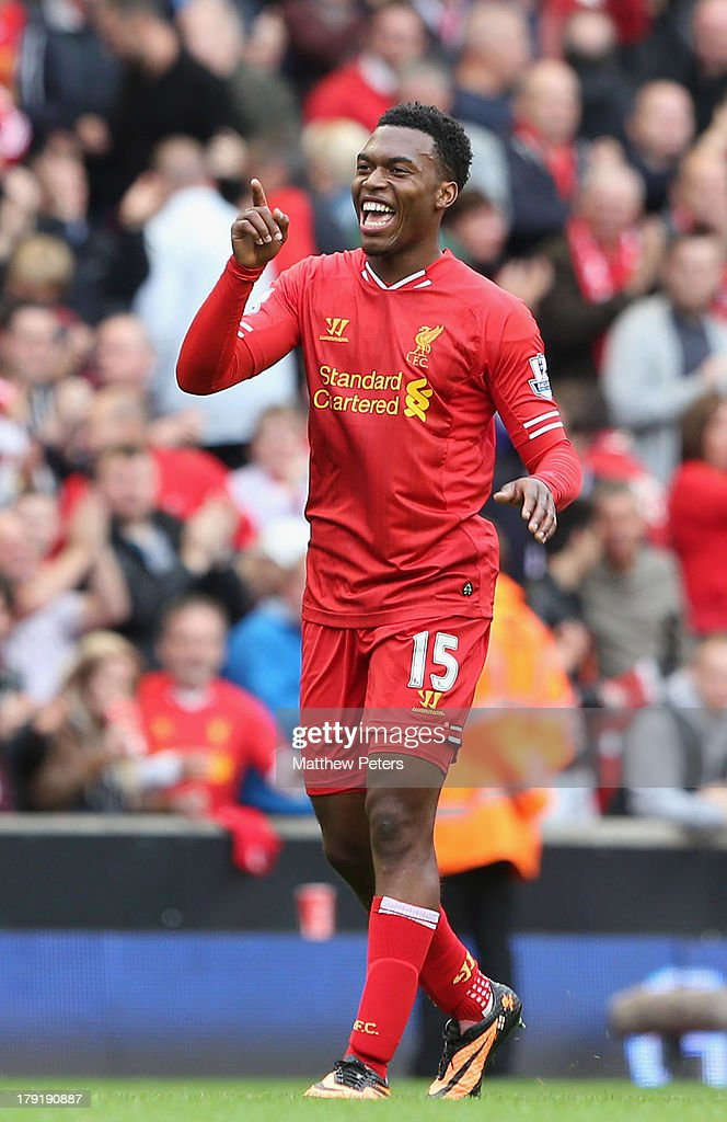 Daniel Sturridge of Liverpool celebrates at the final whistle of the Barclays Premier League match between Liverpool and Manchester United at Anfield on September 01, 2013 in Liverpool, England.