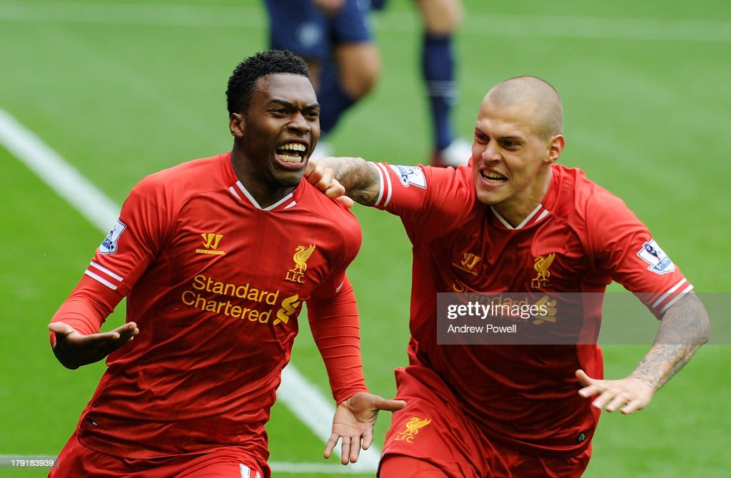 Daniel Sturridge of Liverpool celebrates his goal to make it 1-0 with Martin Skrtel of Liverpool during the Barclays Premier League match between Liverpool and Manchester United at Anfield on September 01, 2013 in Liverpool, England.