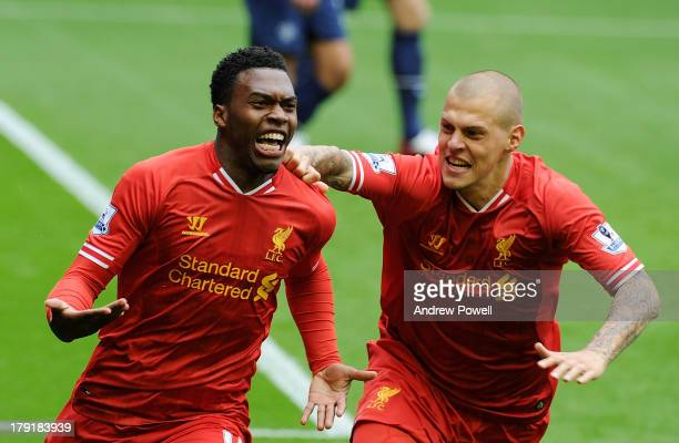 Daniel Sturridge of Liverpool celebrates his goal to make it 10 with Martin Skrtel of Liverpool during the Barclays Premier League match between...
