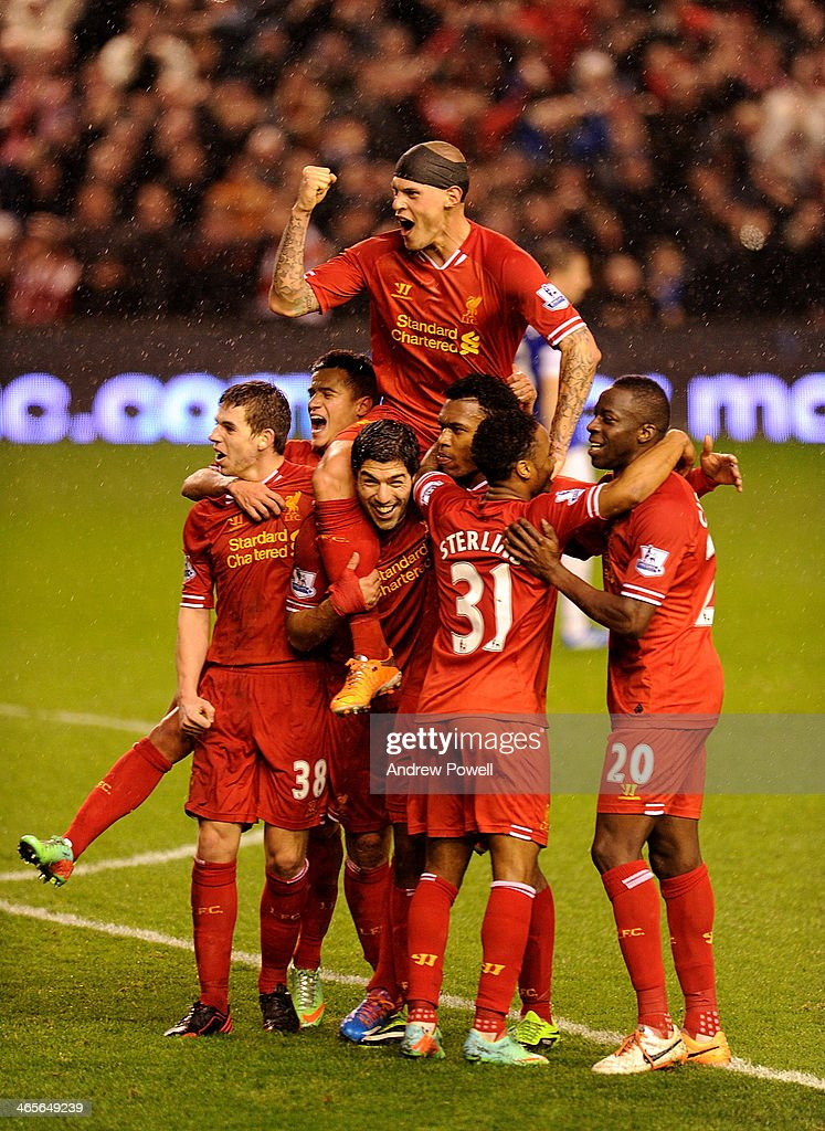 Daniel Sturridge of Liverpool celebrates his goal with his teammates during the Barclays Premier League match between Liverpool and Everton at Anfield on January 28, 2014 in Liverpool, England.