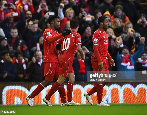 Daniel Sturridge of Liverpool celebrates his goal with Philippe Coutinho of Liverpool during the Barclays Premier League match between Liverpool and...