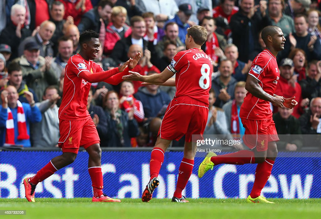Daniel Sturridge (L) of Liverpool celebrates his goal with Steven Gerrard during the Barclays Premier League match between Liverpool and Southampton at Anfield on August 17, 2014 in Liverpool, England.