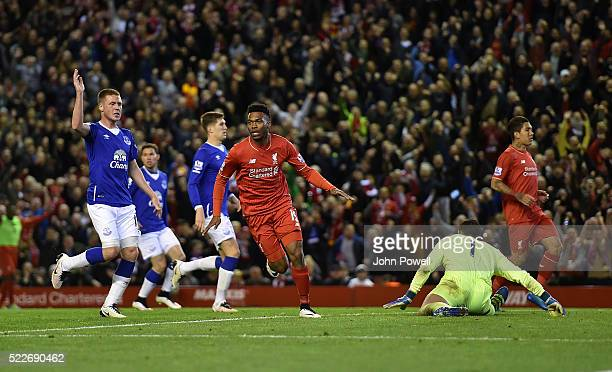 Daniel Sturridge of Liverpool celebrates scoring a goal during the Barclays Premier League match between Liverpool and Everton at Anfield on April 20...