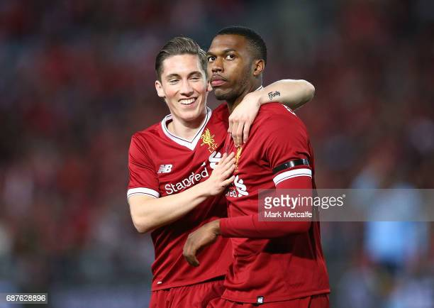 Daniel Sturridge of Liverpool celebrates scoring a goal with team mate Harry Wilson during the International Friendly match between Sydney FC and...