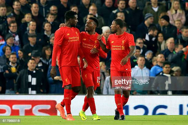 Daniel Sturridge of Liverpool celebrates scoring his sides first goal with his Liverpool team mates during the EFL Cup fourth round match between...