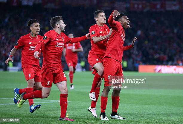 Daniel Sturridge of Liverpool celebrates scoring his team's first goal with his team mates Roberto Firmino Adam Lallana and Philippe Coutinho during...
