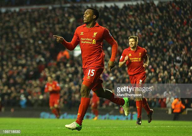 Daniel Sturridge of Liverpool celebrates scoring his team's third goal during the Barclays Premier League match between Liverpool and Norwich City at...