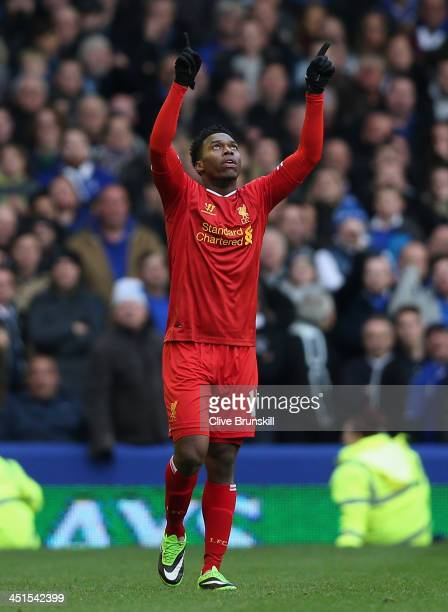 Daniel Sturridge of Liverpool celebrates scoring his team's third goal during the Barclays Premier League match between Everton and Liverpool at...