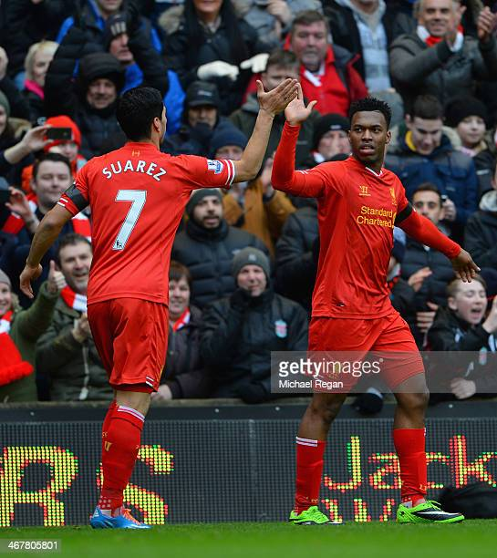 Daniel Sturridge of Liverpool celebrates scoring the fourth goal with teammate Luis Suarez during the Barclays Premier League match between Liverpool...